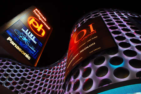 planet hollywood casino entrance with dazzling lights in las vegas
