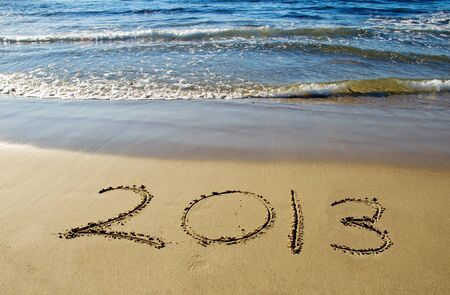 2013 new year written in sand on the beach photo