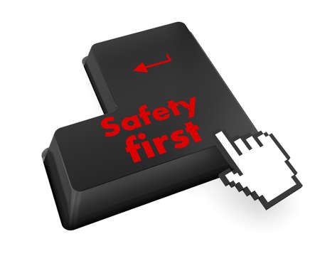 safety first concept with red key on computer keyboard photo