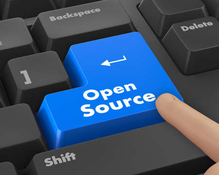open source: Hand pushing  open source keyboard button Stock Photo
