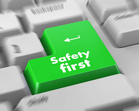 safety first concept with red key on computer keyboard Stok Fotoğraf