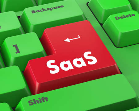 service providers: SAAS - Software as a Service - on Red Button on Black Computer Keyboard. Stock Photo