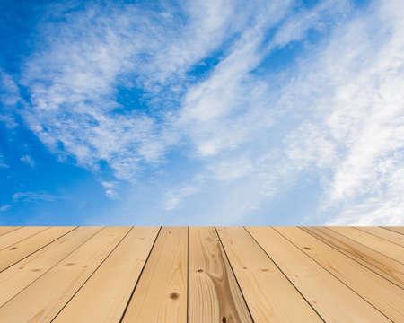 on wood floor: blue  sky and wood floor, background
