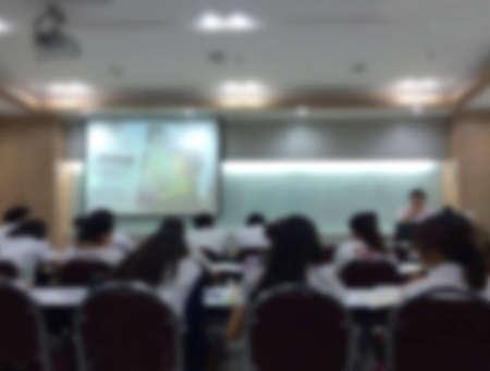 blur students  and teacher in the classroom for background usage. Stock Photo