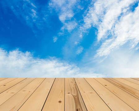on wood floor: blue sky and wood floor, background Stock Photo