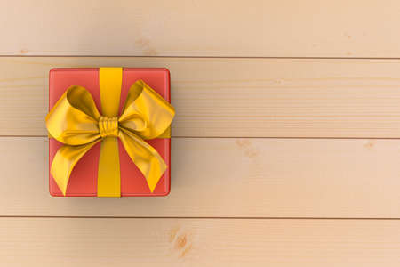 top year: gift box on top view,This gift box for Christmas New Year and birthday celebration ,red gift box with yellow bow on wood background 3d rendering Stock Photo