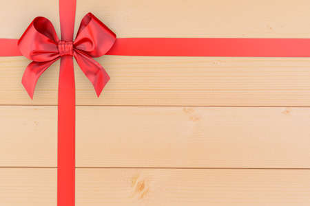 top year: red ribbon bow on top view,red ribbon bow  for Christmas New Year and birthday celebration ,red ribbon bow on wood background and copy space 3d rendering