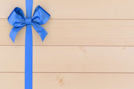 top of the year: blue ribbon bow on top view,blue ribbon bow  for Christmas New Year and birthday celebration ,blue ribbon bow on wood background and copy space 3d rendering