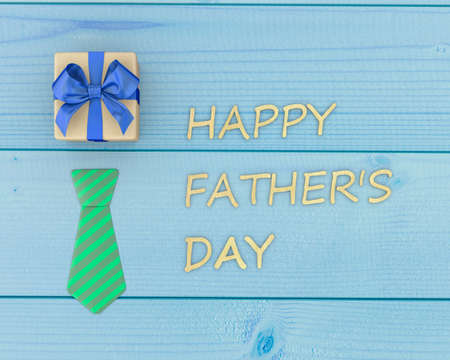 lazo regalo: Fathers day composition of  tie laid and fathers day gift box on wooden floor background 3d rendering
