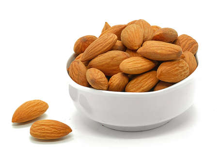 almonds isolated on the white background Imagens
