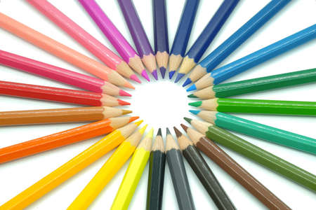 colored pencils on white background focus and unity concept Stock Photo