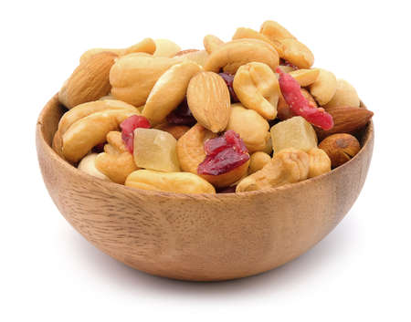 Mixed nuts in a bowl on white wood background. Stock Photo