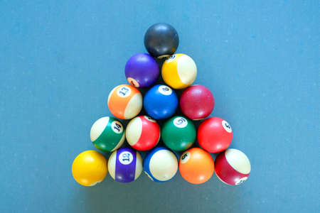 Billiard balls arranged in a triangle