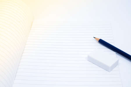 pencil eraser rubber and blank white notebook for write your