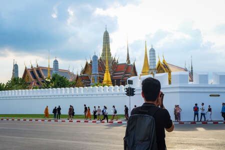 Bangkok, Thailand - November 10, 2017 : Beautiful Grand palace & Wat phra keaw (Wat Phra Sri Rattana Satsadaram) with the man taking pictures or photo and people (Famous buddhist temple for tourist).