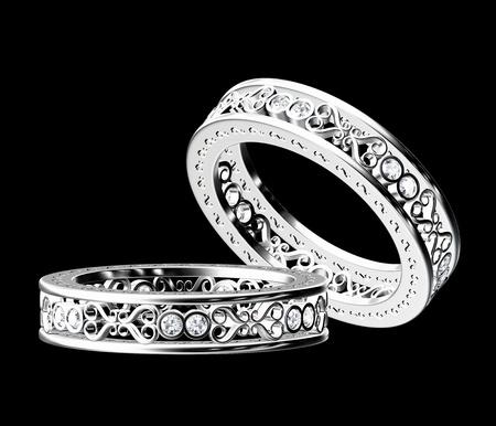 White gold diamond ring isolated on black background. photo