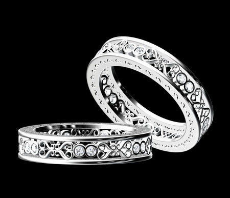 fake diamond: White gold diamond ring isolated on black background. Stock Photo