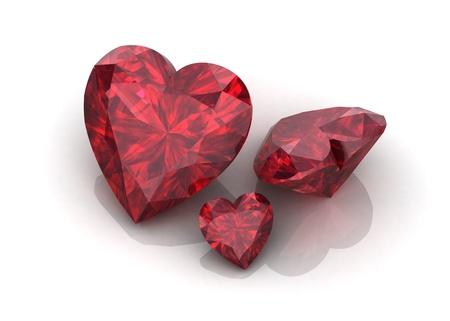Heart shaped ruby gemstone on white backgroun photo