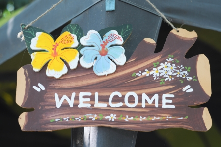 welcome sign on the wood photo