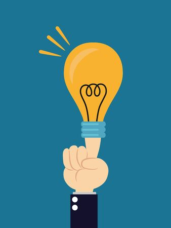 Light bulb lit from human hand on blue background photo