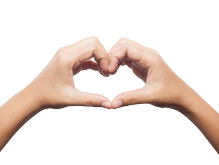 hardships: Woman hands in the form of little heart isolated on white background