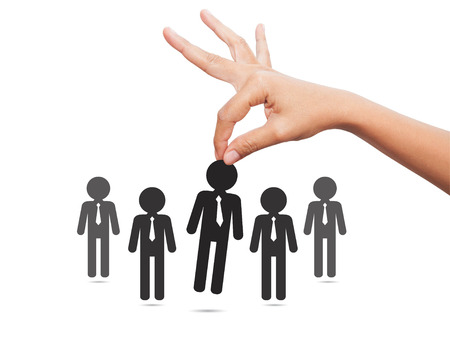 hand job: Choosing the best candidate concept for the job concept. Hand picking up a businessman stick figure from the row. Flat design Stock Photo
