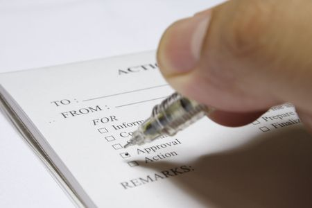 a close-up shot of an action slip being ticked