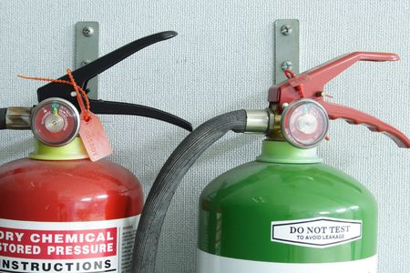 foam safe: Photo of a pair of fire extinguisher.