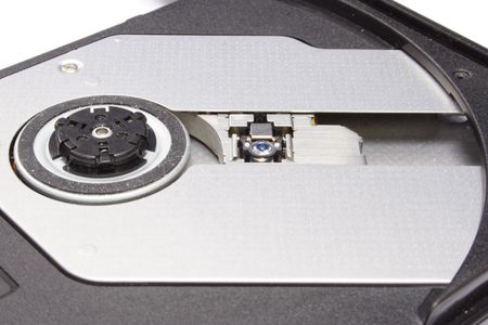 close-up photo of a notebook cd drive lens.