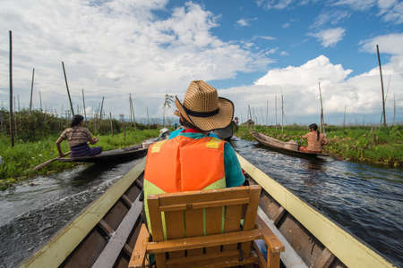 ecotourism: The tourist travel in Inle lake, Myanmar. Stock Photo