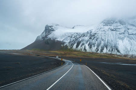 long road: The beautiful scenery and empty long road in Iceland.