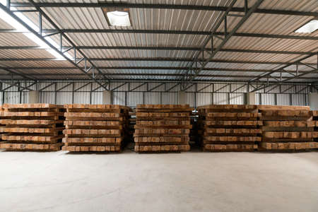 The group of wooden pallet in the factory. Pallet is a busy noun, but its mainly a slab or framework of wood used for carrying things. The most common type of pallet is the kind used to move cargo.