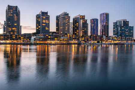 The reflection of Docklands waterfront area in Melbourne at night, Australia.