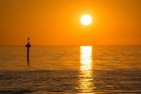 scenic spots: Beautiful sunset over the sea at Frankston beach suburb of Melbourne, Australia. Stock Photo