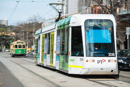 Melbourne, AUSTRALIA - August 22 2015: Melbourne Tram the iconic famous transportation in the town of Melbourne. You can see the new and old model of Melbourne tram in this picture. 新闻类图片