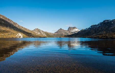 The spectacular view of Dove lake with reflection of Cradle mountain the world heritage sites of Tasmania state of Australia.