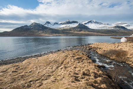 Beautiful mountains in Stoovarfjorour the fisherman village in east fjord of east Iceland. Stok Fotoğraf
