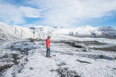 Tourist travel and visiting Skaftafell glacier of Vatnajokull national park in southern Iceland.