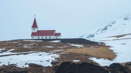 Reyniskirkja church an iconic landmark church of Vik the famous town in Southern region of Iceland in winter season.