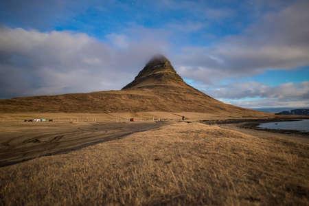 Kirkjufell the iconic landmark of Iceland under the moonlight located at Snaefellsnes peninsula, near the town of Grundarfjordur.