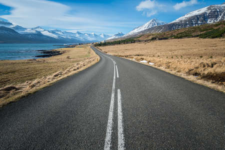 The empty countryside road and beautiful scenery in Iceland.