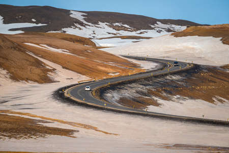 The beautiful S-curve road and the beautiful landscape in Northern region of Iceland in winter season. Stok Fotoğraf