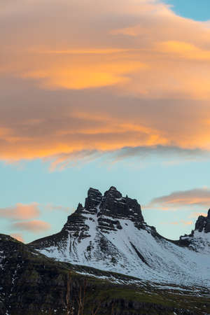 The beautiful mountain and spectacular clouds during the sunset in Stoovarfjorour town of East Iceland.