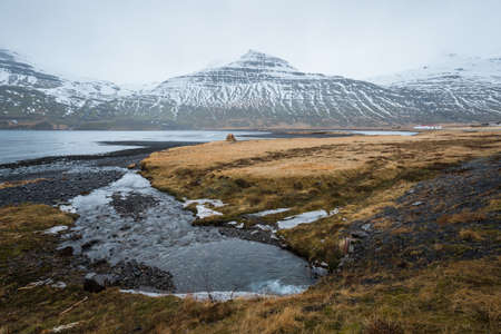 The beautiful scenery view of mountains in Stodvarfjordur of East Iceland in the cloudy day. Stok Fotoğraf