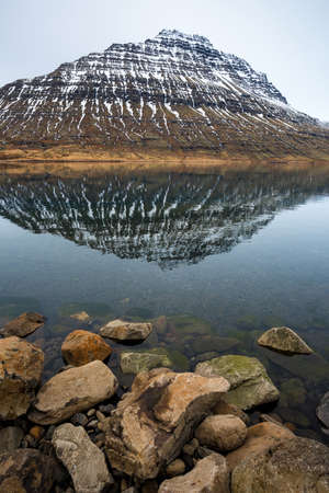 Holmatindur the mighty mountain of Eskifjordur town in East fjord of East Iceland. Stok Fotoğraf