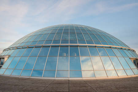 REYKJAVIK, ICELAND - MARCH 26 2016: The glass room on the top of Perlan is a landmark building in Reykjavik, the capital of Iceland. It was originally designed by Ingimundur Sveinsson.