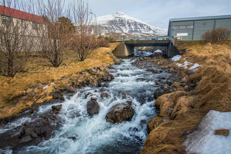 The river flowing from the mountains in Stodvarfjordur town of East Iceland.