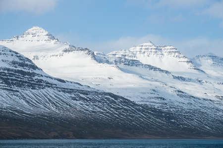 The beautiful scenery of snowy mountain in Stodvarfjordur of East Iceland in winter season.