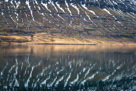 The reflection of Holmatindur the mighty mountain in east Iceland.
