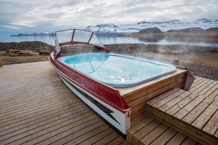 An iconic boat hot tub outside the local guesthouse of Mjoeyri nearly Eskifjordur town of east fjord of Iceland. 版權商用圖片